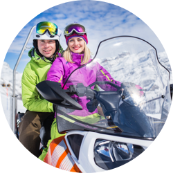 couple on snow mobile